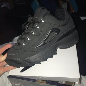 Worn once black filas (fits a women's us 7)